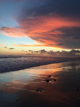 The most beautiful sunset in the world, on the main beach of Santa Teresa.